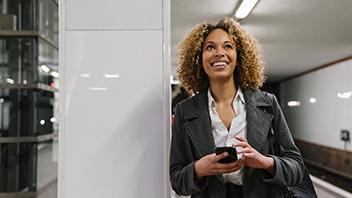 happy-woman-on-train-station